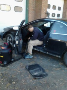 web community partners student working in his paid position at the montpelier auto clinic